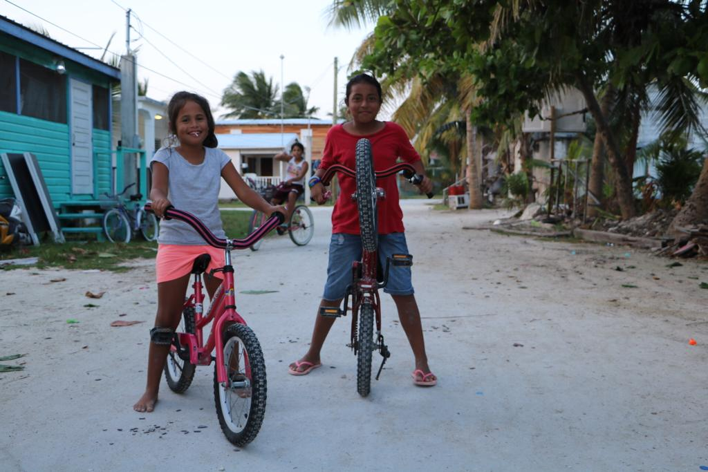 Caye Caulker, Belize, Girls in bikes